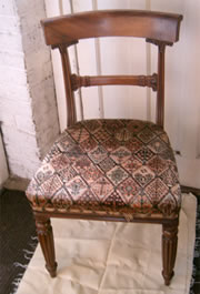 A set of 4 golden mahogany late Regency bar back chairs with fluted legs