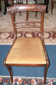 A very good set of 8 Regency mahogany dining chairs