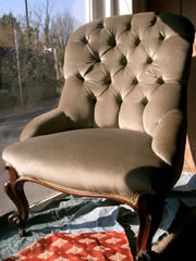 A very good Victorian buttoned back chair with mahogany cabriole legs