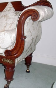 Double scroll end Victorian sofa with raised back