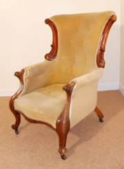 A Fine Victorian Carved Armchair with Button Back c1860